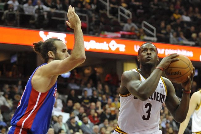 Apr 9, 2014; Cleveland, OH, USA; Cleveland Cavaliers guard Dion Waiters (3) drives against Detroit Pistons forward Luigi Datome (13) in the fourth quarter at Quicken Loans Arena. Mandatory Credit: David Richard-USA TODAY Sports