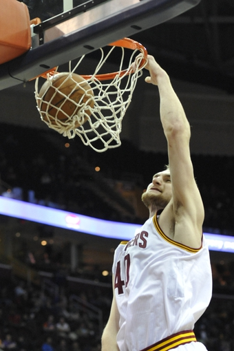 Apr 9, 2014; Cleveland, OH, USA; Cleveland Cavaliers center Tyler Zeller (40) dunks in the fourth quarter agains the Detroit Pistons at Quicken Loans Arena. Mandatory Credit: David Richard-USA TODAY Sports