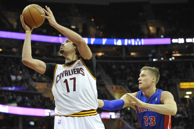 Apr 9, 2014; Cleveland, OH, USA; Cleveland Cavaliers center Anderson Varejao (17) shoots the ball in front of Detroit Pistons forward Jonas Jerebko (33) in the third quarter at Quicken Loans Arena. Mandatory Credit: David Richard-USA TODAY Sports