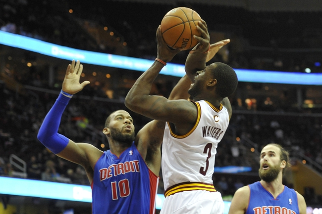 Apr 9, 2014; Cleveland, OH, USA; Cleveland Cavaliers guard Dion Waiters (3) shoots the ball between Detroit Pistons forward Greg Monroe (10) and forward Luigi Datome (13) in the fourth quarter at Quicken Loans Arena. Mandatory Credit: David Richard-USA TODAY Sports