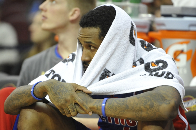 Apr 9, 2014; Cleveland, OH, USA; Detroit Pistons guard Brandon Jennings (7) sits on the bench in the fourth quarter against the Cleveland Cavaliers at Quicken Loans Arena. Mandatory Credit: David Richard-USA TODAY Sports
