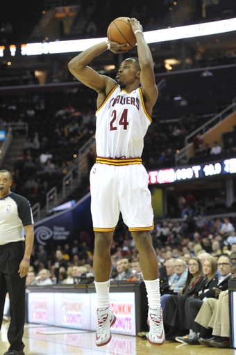 Apr 9, 2014; Cleveland, OH, USA; Cleveland Cavaliers guard Scotty Hopson (24) shoots the ball in the fourth quarter against the Detroit Pistons at Quicken Loans Arena. Mandatory Credit: David Richard-USA TODAY Sports