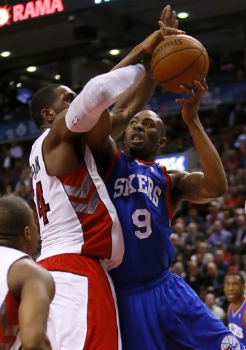 Apr 9, 2014; Toronto, Ontario, CAN; Toronto Raptors forward Patrick Patterson (54) and guard Terrence Ross (31) defend against Philadelphia 76ers guard-forwad James Anderson (9) at the Air Canada Centre. Toronto defeated Philadelphia 125-114. Mandatory Credit: John E. Sokolowski-USA TODAY Sports