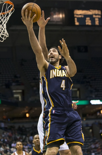 Apr 9, 2014; Milwaukee, WI, USA; Indiana Pacers forward Luis Scola (4) shoots the ball during the third quarter against the Milwaukee Bucks at BMO Harris Bradley Center. Mandatory Credit: Jeff Hanisch-USA TODAY Sports