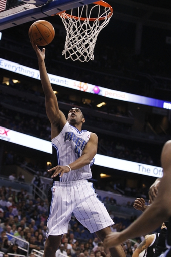 Apr 9, 2014; Orlando, FL, USA; Orlando Magic guard Arron Afflalo (4) shoots against the Brooklyn Nets during the second half at Amway Center. Orlando Magic defeated the Brooklyn Nets 115-111. Mandatory Credit: Kim Klement-USA TODAY Sports