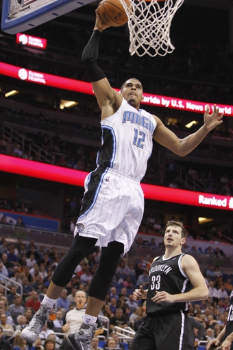 Apr 9, 2014; Orlando, FL, USA; Orlando Magic forward Tobias Harris (12) dunks against the Brooklyn Nets during the second half at Amway Center. Orlando Magic defeated the Brooklyn Nets 115-111. Mandatory Credit: Kim Klement-USA TODAY Sports