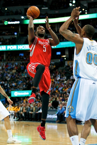 Apr 9, 2014; Denver, CO, USA; Houston Rockets small forward Jordan Hamilton (5) takes a shot against Denver Nuggets power forward Darrell Arthur (00) in the second quarter at the Pepsi Center. Mandatory Credit: Isaiah J. Downing-USA TODAY Sports