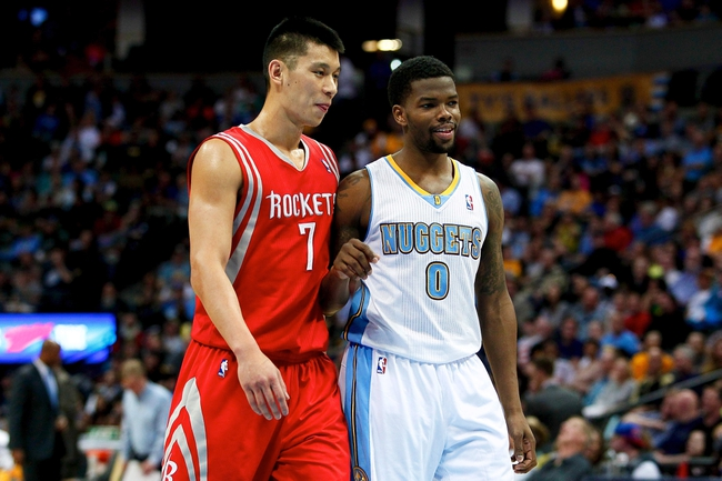 Apr 9, 2014; Denver, CO, USA; Houston Rockets point guard Jeremy Lin (7) talks with Denver Nuggets point guard Aaron Brooks (0) in the second quarter at the Pepsi Center. Mandatory Credit: Isaiah J. Downing-USA TODAY Sports