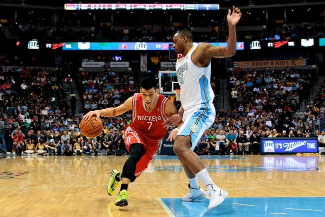Apr 9, 2014; Denver, CO, USA; Denver Nuggets power forward Darrell Arthur (00) guards Houston Rockets point guard Jeremy Lin (7) in the second quarter at the Pepsi Center. Mandatory Credit: Isaiah J. Downing-USA TODAY Sports