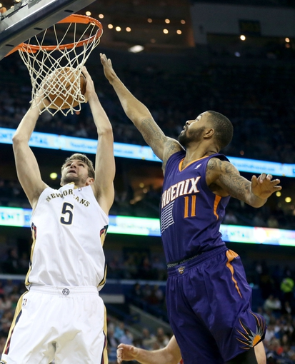 Apr 9, 2014; New Orleans, LA, USA; New Orleans Pelicans center Jeff Withey (5) shoots the ball as Phoenix Suns forward Markieff Morris (11) defends in the second half at the Smoothie King Center. The Suns won 94-88. Mandatory Credit: Crystal LoGiudice-USA TODAY Sports