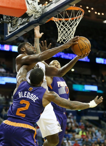Apr 9, 2014; New Orleans, LA, USA; New Orleans Pelicans forward Tyreke Evans (1) shoots the ball as Phoenix Suns guard Eric Bledsoe (2) defends in the second half at the Smoothie King Center. The Suns won 94-88. Mandatory Credit: Crystal LoGiudice-USA TODAY Sports
