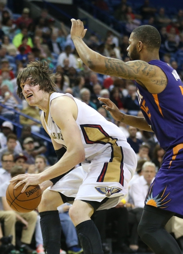 Apr 9, 2014; New Orleans, LA, USA; New Orleans Pelicans forward Luke Babbitt (8) dribbles the ball in front of Phoenix Suns forward Marcus Morris (15) in the second half at the Smoothie King Center. The Suns won 94-88. Mandatory Credit: Crystal LoGiudice-USA TODAY Sports