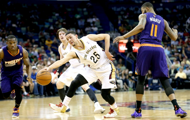 Apr 9, 2014; New Orleans, LA, USA; New Orleans Pelicans guard Austin Rivers (25) dribbles the ball in front of Phoenix Suns forward Markieff Morris (11) in the second half at the Smoothie King Center. The Suns won 94-88. Mandatory Credit: Crystal LoGiudice-USA TODAY Sports