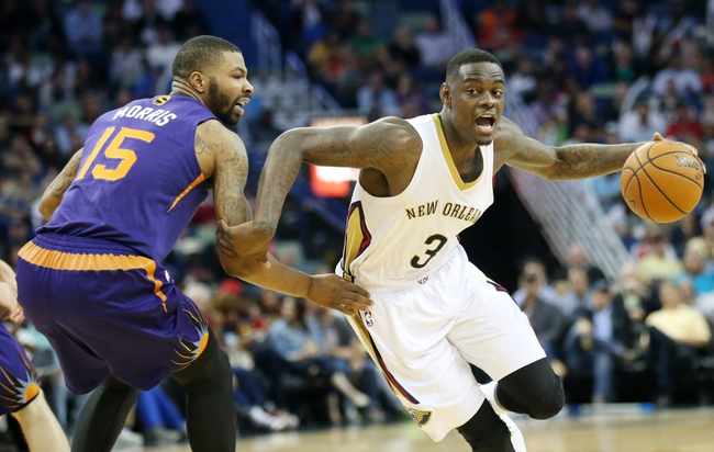 Apr 9, 2014; New Orleans, LA, USA; New Orleans Pelicans guard Anthony Morrow (3) dribbles the ball around Phoenix Suns forward Marcus Morris (15) in the second half at the Smoothie King Center. The Suns won 94-88. Mandatory Credit: Crystal LoGiudice-USA TODAY Sports