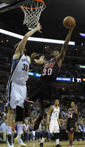 Apr 9, 2014; Memphis, TN, USA; Miami Heat guard Norris Cole (30) shoots over Memphis Grizzlies center Marc Gasol (33) during the game at FedExForum. Memphis Grizzlies beat the Miami Heat 107 - 102. Mandatory Credit: Justin Ford-USA TODAY Sports
