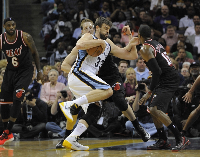 Apr 9, 2014; Memphis, TN, USA; Memphis Grizzlies center Marc Gasol (33) drives against Miami Heat center Justin Hamilton (7) during the game at FedExForum. Memphis Grizzlies beat the Miami Heat 107 - 102. Mandatory Credit: Justin Ford-USA TODAY Sports