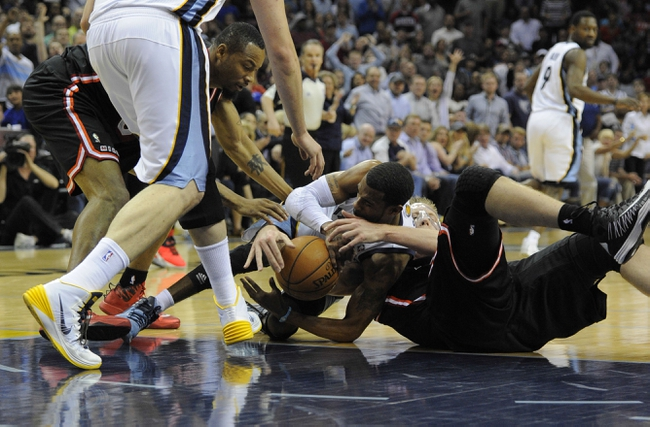 Apr 9, 2014; Memphis, TN, USA; Memphis Grizzlies guard Mike Conley (11) and Miami Heat center Justin Hamilton (7) fight for the ball during the game at FedExForum. Memphis Grizzlies beat the Miami Heat 107 - 102. Mandatory Credit: Justin Ford-USA TODAY Sports