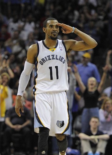 Apr 9, 2014; Memphis, TN, USA; Memphis Grizzlies guard Mike Conley (11) reacts after the play against the Miami Heat at FedExForum. Memphis Grizzlies beat the Miami Heat 107 - 102. Mandatory Credit: Justin Ford-USA TODAY Sports