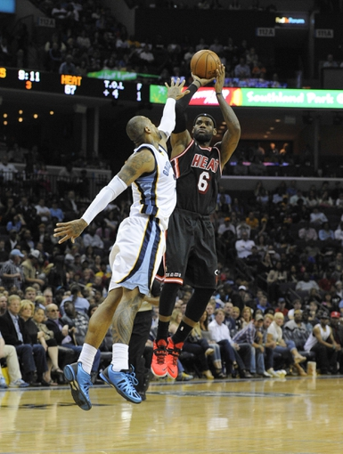 Apr 9, 2014; Memphis, TN, USA; Miami Heat forward LeBron James (6) shoots over Memphis Grizzlies forward James Johnson (3) during the game at FedExForum. Memphis Grizzlies beat the Miami Heat 107 - 102. Mandatory Credit: Justin Ford-USA TODAY Sports
