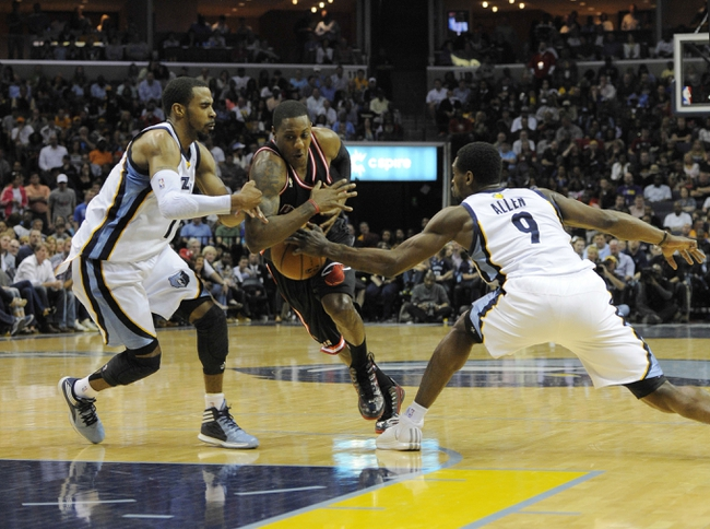 Apr 9, 2014; Memphis, TN, USA; Memphis Grizzlies guard Tony Allen (9) steals the ball from Miami Heat guard Mario Chalmers (15) during the game at FedExForum. Memphis Grizzlies beat the Miami Heat 107 - 102. Mandatory Credit: Justin Ford-USA TODAY Sports
