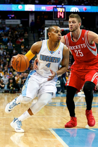 Apr 9, 2014; Denver, CO, USA; Houston Rockets small forward Chandler Parsons (25) guards Denver Nuggets point guard Randy Foye (4) in the third quarter at the Pepsi Center. The Nuggets won 123-116. Mandatory Credit: Isaiah J. Downing-USA TODAY Sports