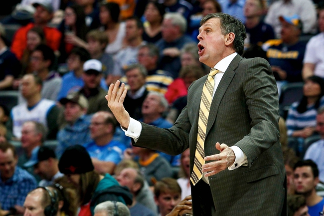 Apr 9, 2014; Denver, CO, USA; Houston Rockets head coach Kevin McHale reacts to a play in the third quarter against the Denver Nuggets at the Pepsi Center. The Nuggets won 123-116. Mandatory Credit: Isaiah J. Downing-USA TODAY Sports