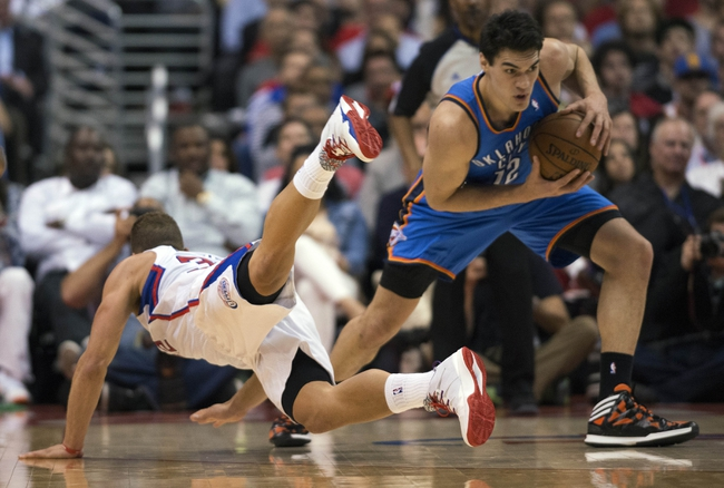 Apr 9, 2014; Los Angeles, CA, USA; Los Angeles Clippers forward Blake Griffin (32) battles for the ball with Oklahoma City Thunder center Steven Adams (12) during the second quarter at Staples Center. Mandatory Credit: Kelvin Kuo-USA TODAY Sports