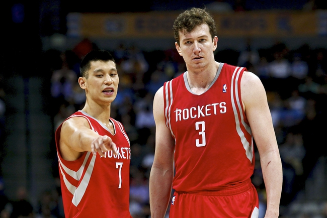 Apr 9, 2014; Denver, CO, USA; Houston Rockets point guard Jeremy Lin (7) talks with center Omer Asik (3) in the second quarter against the Denver Nuggets at the Pepsi Center. Mandatory Credit: Isaiah J. Downing-USA TODAY Sports