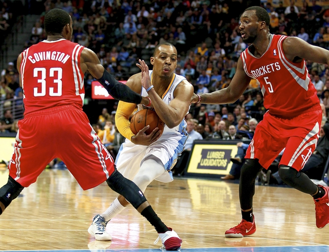 Apr 9, 2014; Denver, CO, USA; Denver Nuggets point guard Randy Foye (4) runs through the defense of Houston Rockets small forward Robert Covington (33) and small forward Jordan Hamilton (5) in the fourth quarter at the Pepsi Center. The Nuggets won 123-116. Mandatory Credit: Isaiah J. Downing-USA TODAY Sports