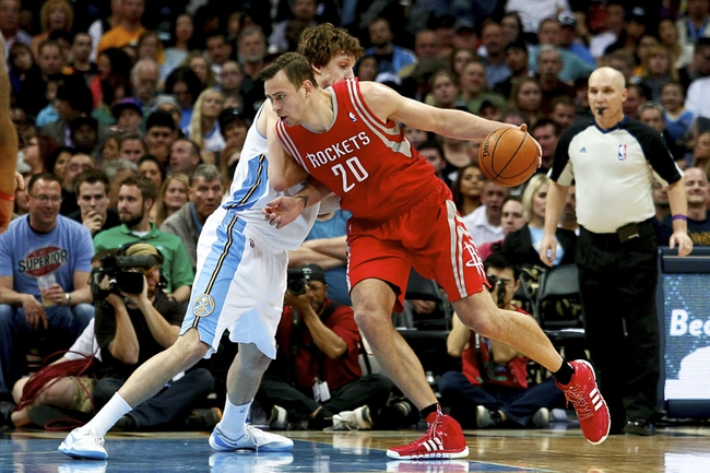 Apr 9, 2014; Denver, CO, USA; Denver Nuggets power forward Jan Vesely (24) guards Houston Rockets power forward Donatas Motiejunas (20) in the fourth quarter at the Pepsi Center. The Nuggets won 123-116. Mandatory Credit: Isaiah J. Downing-USA TODAY Sports
