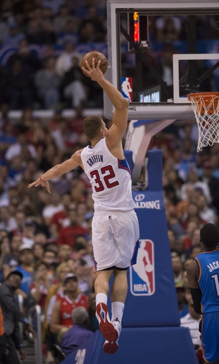 Apr 9, 2014; Los Angeles, CA, USA; Los Angeles Clippers forward Blake Griffin (32) dunks the ball against the Oklahoma City Thunder during the second quarter at Staples Center. Mandatory Credit: Kelvin Kuo-USA TODAY Sports