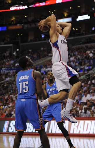 Apr 9, 2014; Los Angeles, CA, USA; Los Angeles Clippers forward Blake Griffin (32) shoots the ball against the Oklahoma City Thunder during the fourth quarter at Staples Center. The Thunder won 107-101. Mandatory Credit: Kelvin Kuo-USA TODAY Sports
