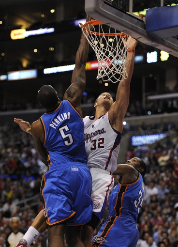 Apr 9, 2014; Los Angeles, CA, USA; Los Angeles Clippers forward Blake Griffin (32) shoots the ball as Oklahoma City Thunder center Kendrick Perkins (5) defends during the fourth quarter at Staples Center. The Thunder won 107-101. Mandatory Credit: Kelvin Kuo-USA TODAY Sports