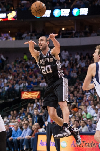 Apr 10, 2014; Dallas, TX, USA; San Antonio Spurs guard Manu Ginobili (20) passes the ball during the second half against the Dallas Mavericks at the American Airlines Center. The Spurs defeated the Mavericks 109-100. Mandatory Credit: Jerome Miron-USA TODAY Sports