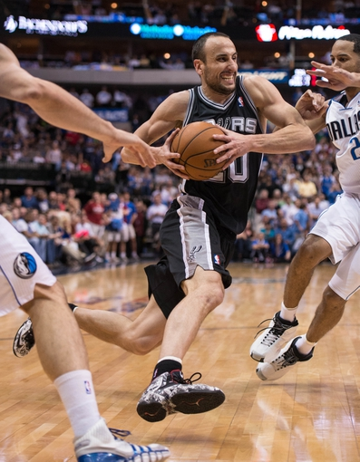 Apr 10, 2014; Dallas, TX, USA; San Antonio Spurs guard Manu Ginobili (20) drives to the basket during the second half against the Dallas Mavericks at the American Airlines Center. The Spurs defeated the Mavericks 109-100. Mandatory Credit: Jerome Miron-USA TODAY Sports