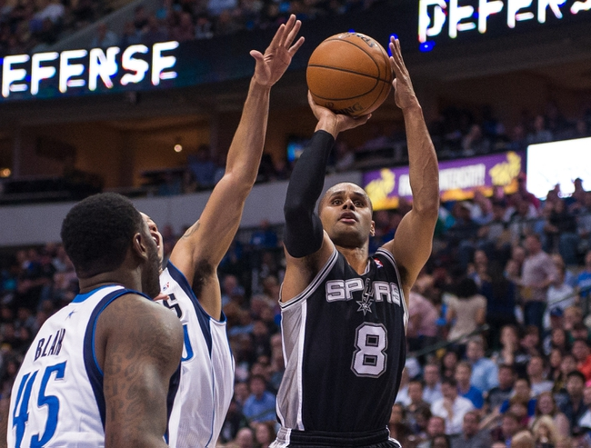 Apr 10, 2014; Dallas, TX, USA; San Antonio Spurs guard Patty Mills (8) shoots over Dallas Mavericks guard Devin Harris (20) during the second half at the American Airlines Center. Mills leads his team with 26 points. The Spurs defeated the Mavericks 109-100. Mandatory Credit: Jerome Miron-USA TODAY Sports