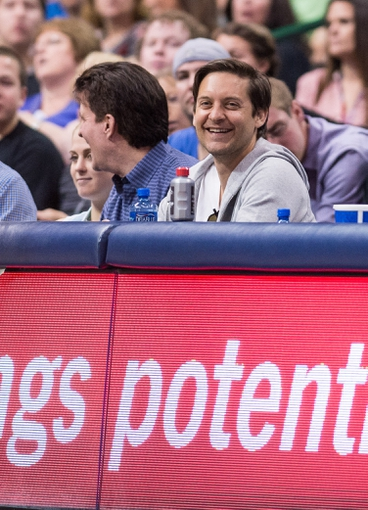 Apr 10, 2014; Dallas, TX, USA; Film actor Tobey Maguire watches the game between the Dallas Mavericks and the San Antonio Spurs at the American Airlines Center. The Spurs defeated the Mavericks 109-100. Mandatory Credit: Jerome Miron-USA TODAY Sports