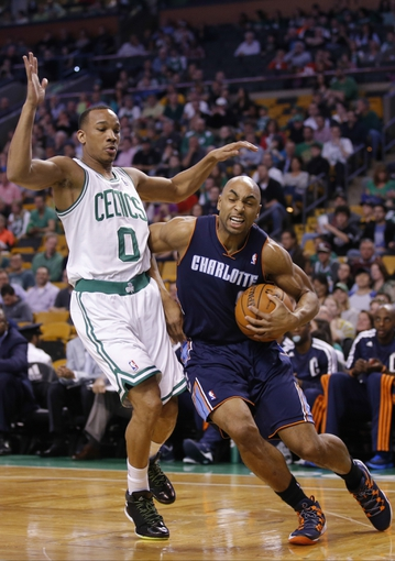 Apr 11, 2014; Boston, MA, USA; Charlotte Bobcats guard Gerald Henderson (9) drives the ball against Boston Celtics guard Avery Bradley (0) in the first quarter at TD Garden. Mandatory Credit: David Butler II-USA TODAY Sports