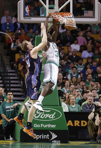 Apr 11, 2014; Boston, MA, USA; Boston Celtics forward Brandon Bass (30) shoots against Charlotte Bobcats center Cody Zeller (40) in the first quarter at TD Garden. Mandatory Credit: David Butler II-USA TODAY Sports