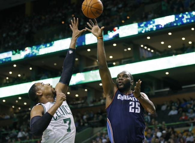 Apr 11, 2014; Boston, MA, USA; Charlotte Bobcats center Al Jefferson (25) shoots against Boston Celtics center Jared Sullinger (7) in the first quarter at TD Garden. Mandatory Credit: David Butler II-USA TODAY Sports
