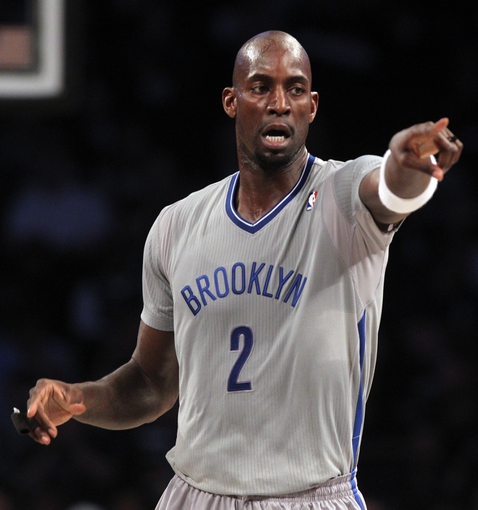 Apr 11, 2014; Brooklyn, NY, USA; Brooklyn Nets center Kevin Garnett (2) points during the first quarter of a game against the Atlanta Hawks at Barclays Center. Mandatory Credit: Brad Penner-USA TODAY Sports