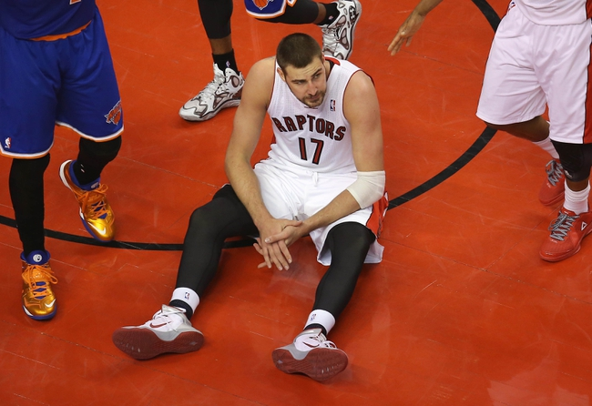 Apr 11, 2014; Toronto, Ontario, CAN; Toronto Raptors center Jonas Valanciunas (17) reacts after falling and being called for a travelling foul against the New York Knicks at Air Canada Centre. Mandatory Credit: Tom Szczerbowski-USA TODAY Sports