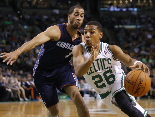 Apr 11, 2014; Boston, MA, USA; Boston Celtics guard Phil Pressey (26) drives the ball against Charlotte Bobcats guard Jannero Pargo (5) in the second quarter at TD Garden. Mandatory Credit: David Butler II-USA TODAY Sports