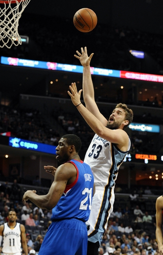 Apr 11, 2014; Memphis, TN, USA; Memphis Grizzlies center Marc Gasol (33) shoots over Philadelphia 76ers forward Thaddeus Young (21) during the game at FedExForum. Mandatory Credit: Justin Ford-USA TODAY Sports