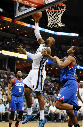 Apr 11, 2014; Memphis, TN, USA; Memphis Grizzlies forward James Johnson (3) lays the ball up against the Philadelphia 76ers during the game at FedExForum. Mandatory Credit: Justin Ford-USA TODAY Sports