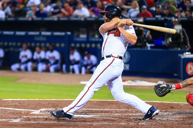 Apr 11, 2014; Atlanta, GA, USA; Atlanta Braves catcher Evan Gattis (24) hits an RBI single in the second inning against the Washington Nationals at Turner Field. Mandatory Credit: Daniel Shirey-USA TODAY Sports
