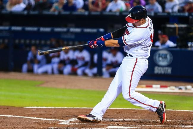 Apr 11, 2014; Atlanta, GA, USA; Atlanta Braves third baseman Ramiro Pena (14) hits a three run home run in the second inning against the Washington Nationals at Turner Field. Mandatory Credit: Daniel Shirey-USA TODAY Sports