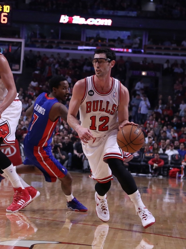 Apr 11, 2014; Chicago, IL, USA; Chicago Bulls guard Kirk Hinrich (12) drives past Detroit Pistons guard Brandon Jennings (7) during the first quarter at the United Center. Mandatory Credit: Dennis Wierzbicki-USA TODAY Sports