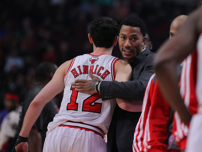 Apr 11, 2014; Chicago, IL, USA; Chicago Bulls guard Kirk Hinrich (12) and guard Derrick Rose (street clothes) prior to the first quarter against the Detroit Pistons at the United Center. Mandatory Credit: Dennis Wierzbicki-USA TODAY Sports