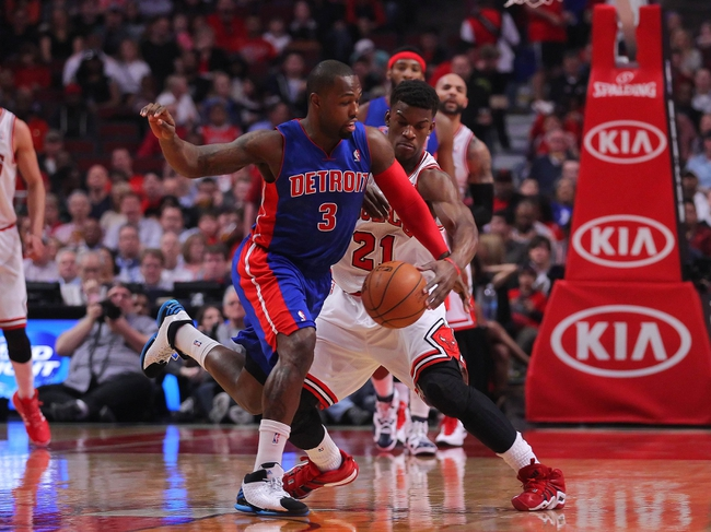 Apr 11, 2014; Chicago, IL, USA; Chicago Bulls guard Jimmy Butler (21) causes Detroit Pistons guard Rodney Stuckey (3) to commit a turnover during the first quarter at the United Center. Mandatory Credit: Dennis Wierzbicki-USA TODAY Sports